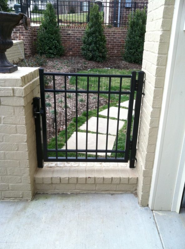 Aluminum pedestrian fence installed by Pro Line Fence Co.
